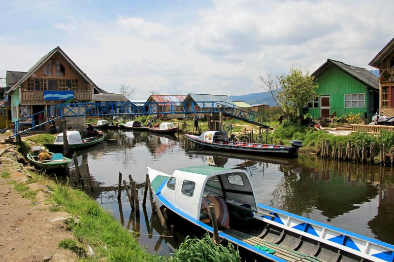 Colorful houses and boats parked on the side of the small river close to the Cocha lake, Colombia royalty free stock photo
