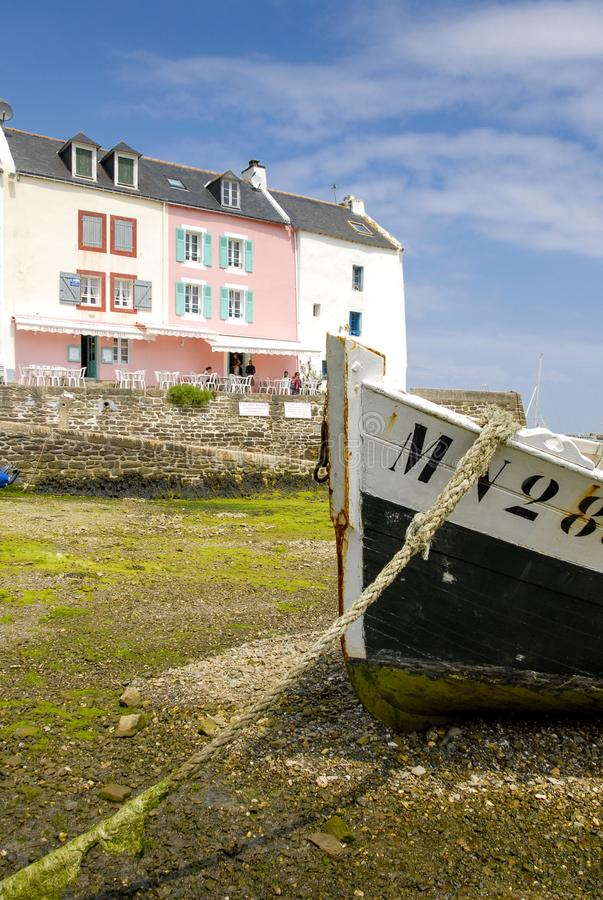 The port of Sauzon in Belle-Ile-en-Mer. Colorful houses and boats stranded in the port of Sauzon, at low tide, Belle-Ile, Brittany stock images