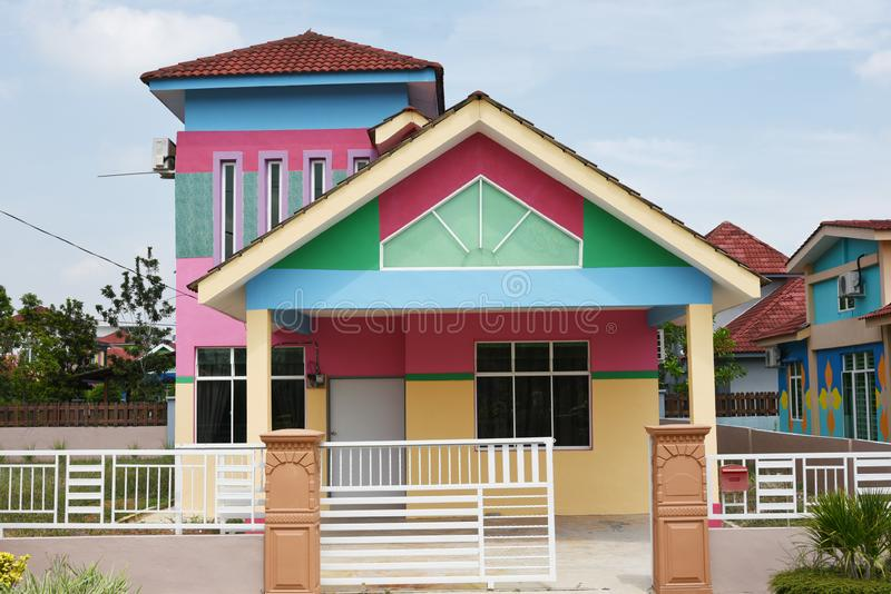 Colorful houses on city street. Colorful street scene with house painted colour stock photos