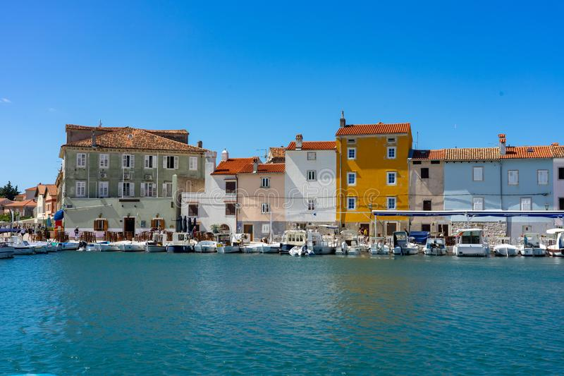 09.02.2019. Cres, Croatia: Colorful houses of Cres old town bay harbor with the sea and boats stock photos