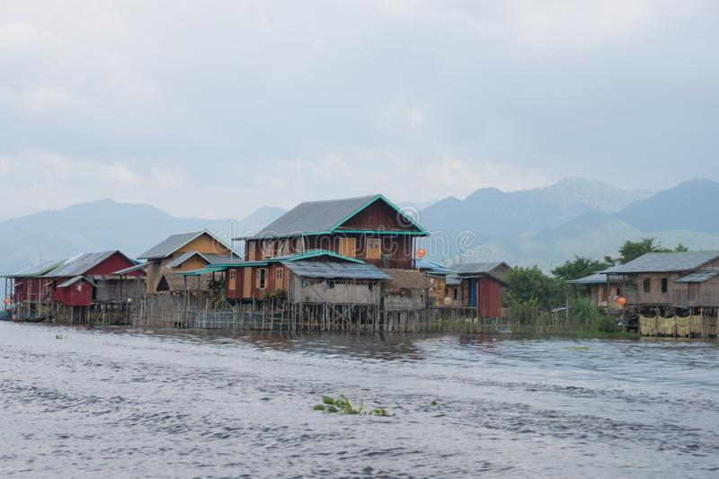 Colorful houses on famous inle lake in central myanmar stock images