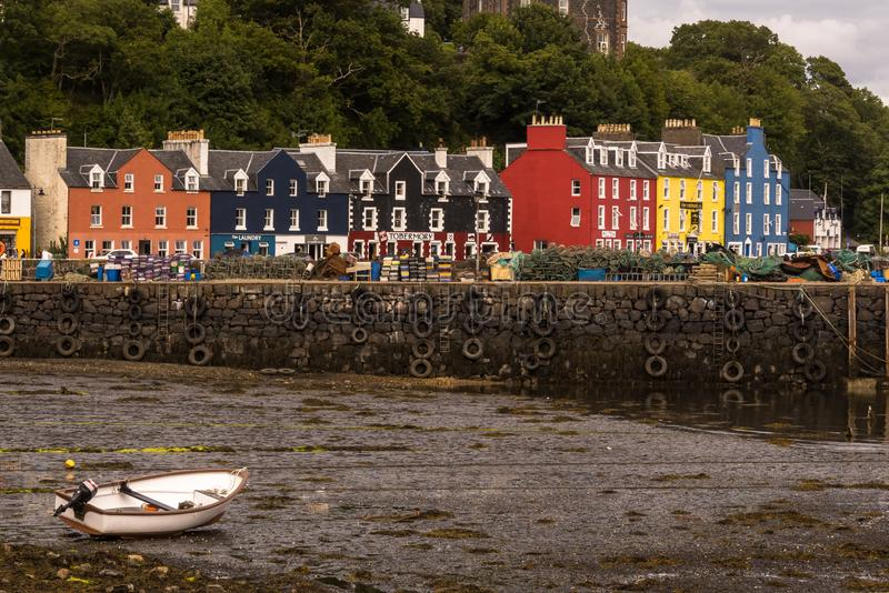 Colorful houses and harbor at low tide, Tobermory stock photography
