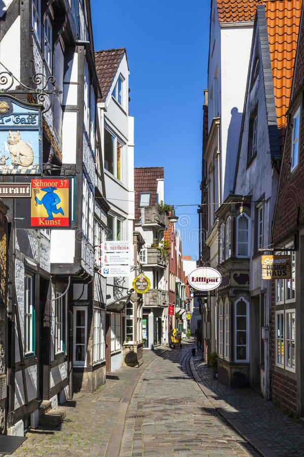 Colorful houses in historic Schnoorviertel in Bremen, Germany. Bremen, Germany - MAY 13, 2016: Houses in the quarter Schnoor, an old town street in downtown stock image