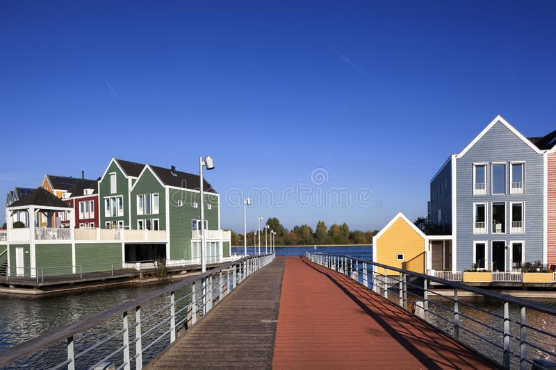 Colorful houses in Houten in the Netherlands. Colorful houses surrounded by water in Houten in the Netherlands royalty free stock photography