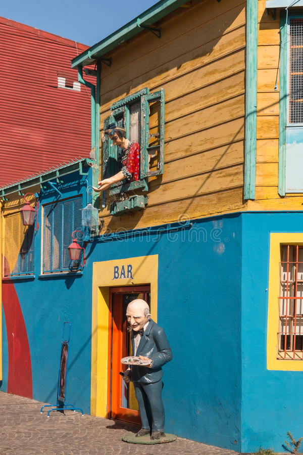 Colorful houses in La Boca, Buenos Aires. Buenos Aires, Argentina - December 21, 2015: lifesize figurines in La Boca district in Buenos Aires stock photos