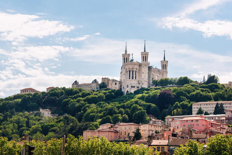 Colorful houses of Lyon and Fourviere Basilica from the Saone riverbank, France.  stock image
