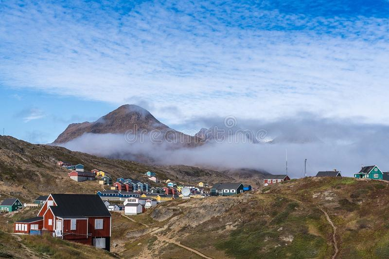 Colorful houses in the mountains of Greenland stock images