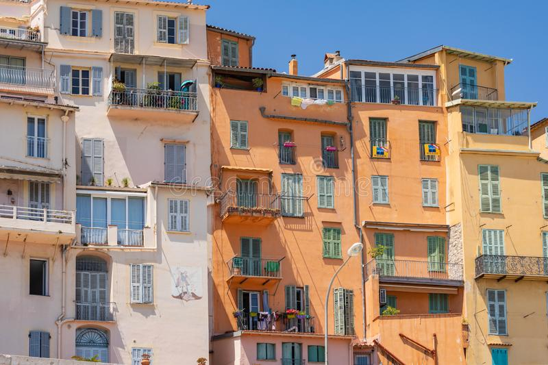 Colorful houses in old town architecture of Menton on French Riviera. Provence-Alpes-Cote d`Azur, France.  royalty free stock photos
