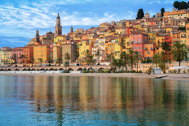 Colorful houses in the Old Town Menton, french Riviera, France. Colorful houses and sand beach in the historical Old Town Menton on french Riviera, France stock photo