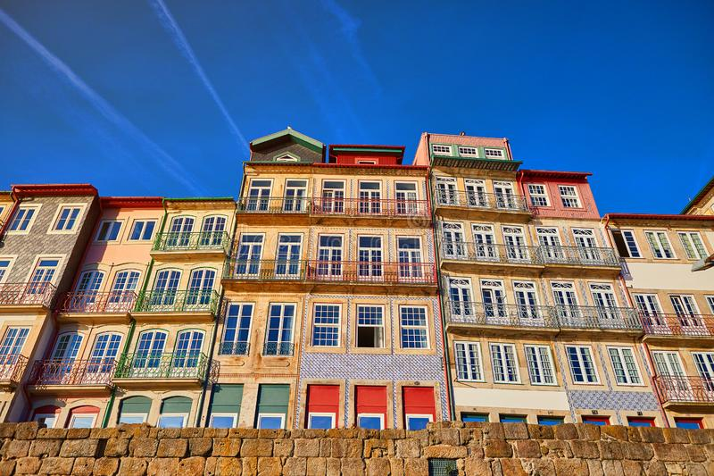 Colorful houses of Porto Ribeira, traditional facades, old multi-colored buildings with red roof tiles on the embankment in the royalty free stock photo