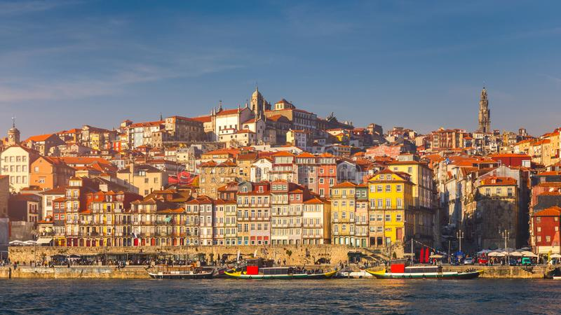 Colorful houses of Porto Ribeira, traditional facades, old multi-colored houses with red roof tiles on the embankment in the city royalty free stock photo