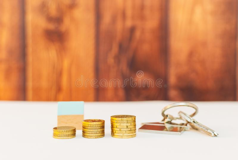 Colorful houses with stack coins. Miniature colorful houses with stack coins on a wooden background using as property and business concept, money, finance stock photos