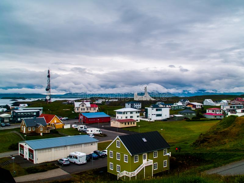 The colorful houses of Stykkishólmur, Iceland with a sky full of coulds wide view royalty free stock photo
