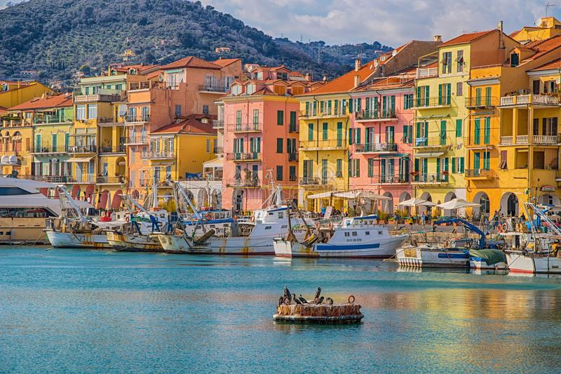 Colorful houses in the town of Oneglia, Imperia, Italy stock photography