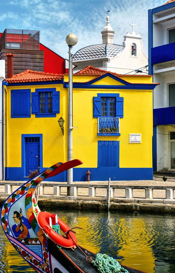 Colorful houses and typical boats in Aveiro stock photo