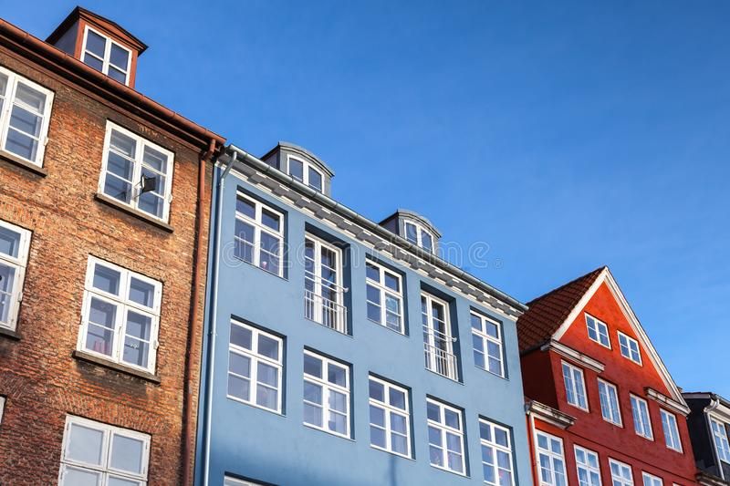 Colorful houses under blue sky in a row. Traditional architecture style of Copenhagen old town, Denmark stock image