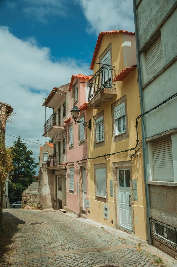 Free Colorful Houses With Public Lamp On Deserted Alley Stock Image - 146755041