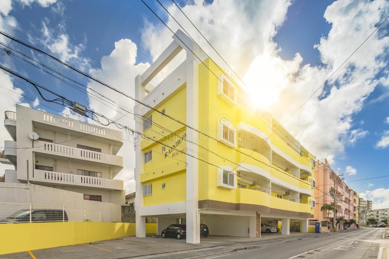 Colorful housing complex Rainbow House â…¢ in the vicinity of the American Village in Chatan City of Okinawa with yellow and royalty free stock image