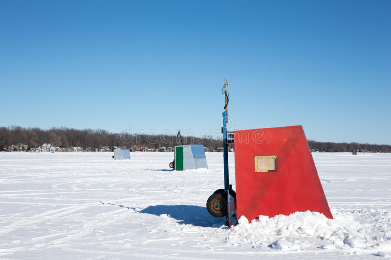 Colorful Ice Shanties on a Frozen Lake. Colorful ice shanties sitting on a frozen lake. Copy space in the sky. Photograph taken on Lake Winnebago, Wisconsin stock photos