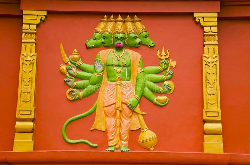 Colorful idol of Lord Hanuman on the outer wall of a temple, on the way to Kanchipuram, Tamil Nadu, India. Colorful idol of Lord Hanuman on the outer wall of a royalty free stock image