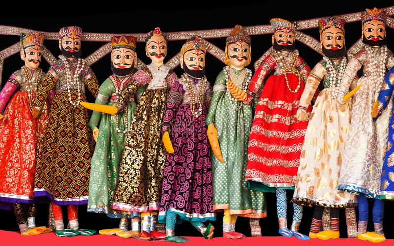 Indian puppets at local market in Jaipur city palace, India. Colorful Indian puppets at local market in Jaipur city palace, Rajasthan, India. Kathputli is a royalty free stock image