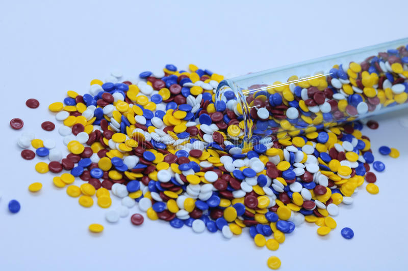 Colorful industrial plastic granules stock image