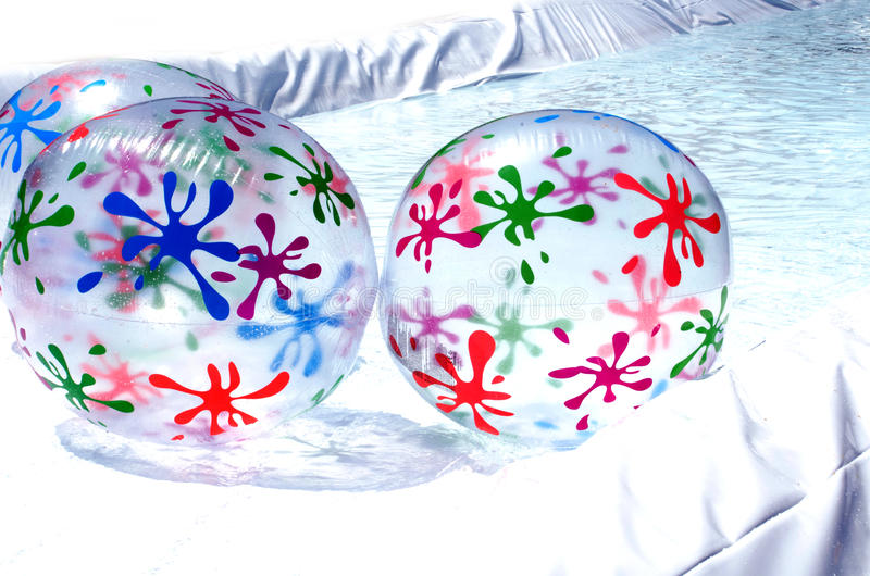 Colorful inflatable beach balls stock photography