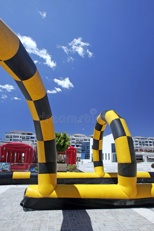 Colorful inflatable go cart track stock photography