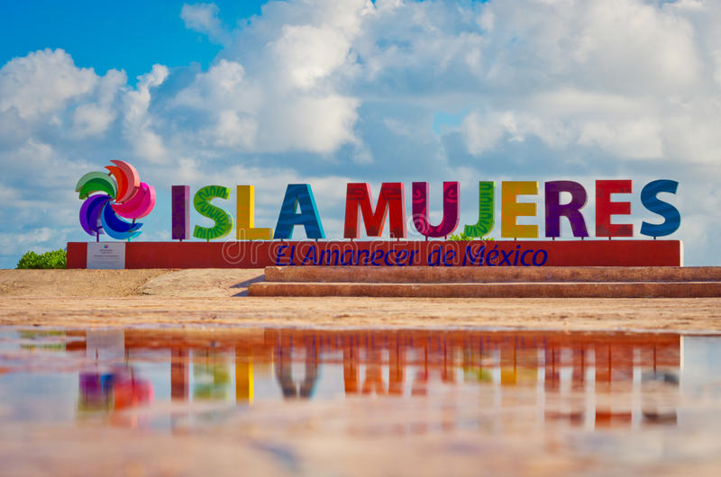 Colorful inscription Isla Mujeres on caribbean sea coast stock images