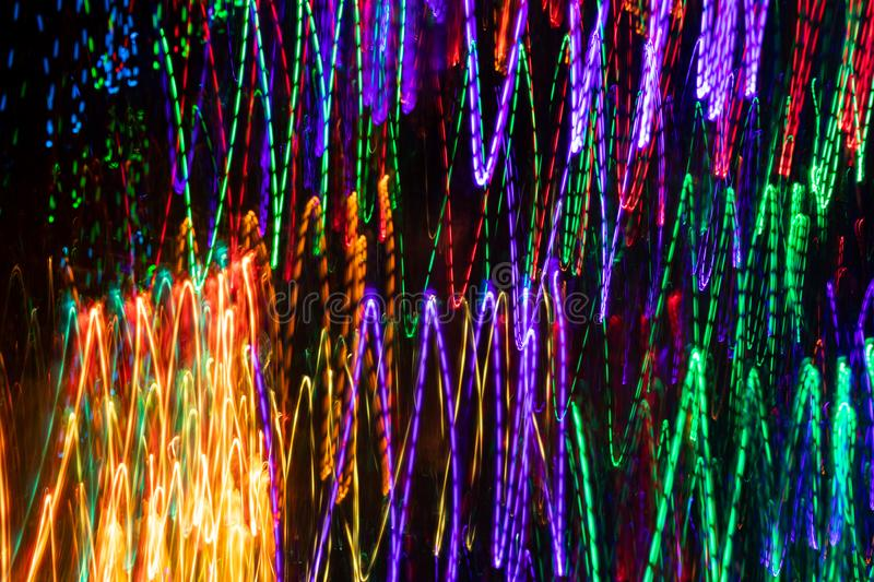 Colorful intermittent and solid light strokes on black backdrop. Abstract background. Photographic effect with long exposure stock photos