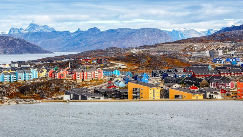 Colorful Inuit buildings in residential district of Nuuk city with lake in the foreground. Greenland royalty free stock photo