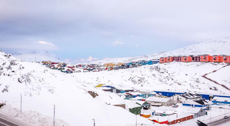Colorful Inuit houses of Nuuk city with  mountains in the background, Greenland. Arctic beauty buildings capital cities climate cold colored colors covered royalty free stock images