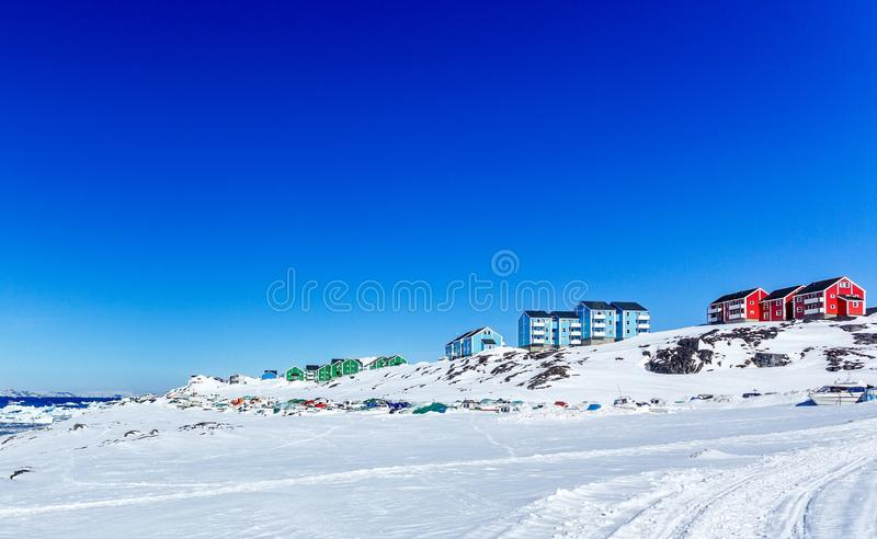 Colorful Inuit houses of Nuuk city with  mountains in the background, Greenland. Arctic beauty buildings capital cities climate cold colored colors covered stock images