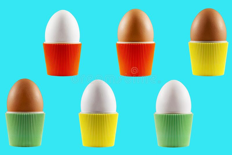 Colorful isolated Easter eggs in cups. From the sixties presented with a blue background stock image