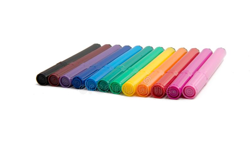 Colorful isolated pens. Or markers on white royalty free stock photos