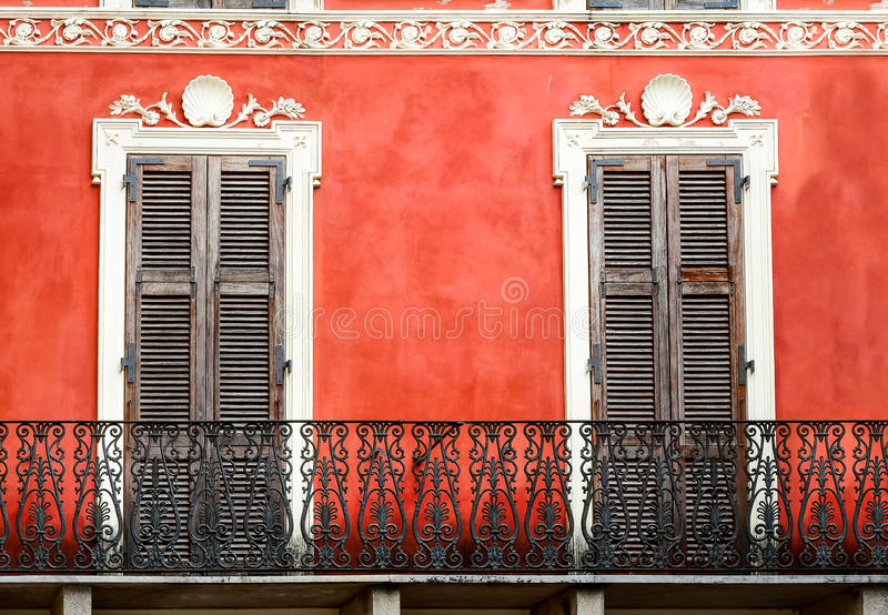 Colorful Italian balcony with doors in vintage style stock image