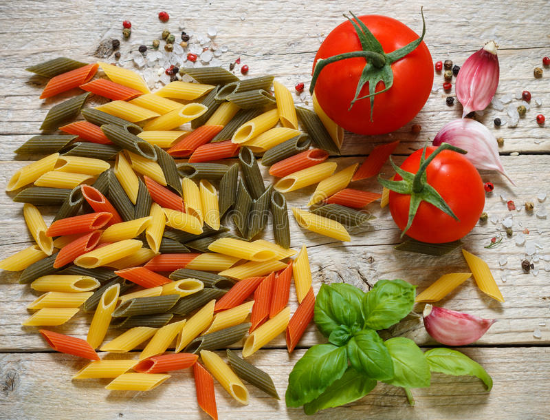 Colorful Italian raw pasta. Pasta penne tricolor royalty free stock photos