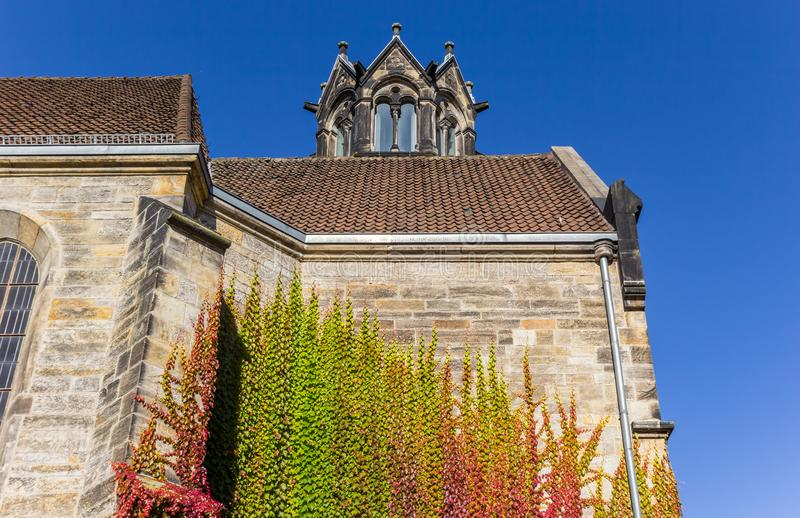 Colorful ivy climbing the evangelical church of Hannover. Germany stock image