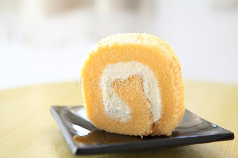 Colorful jam roll. On a plate in close up stock images