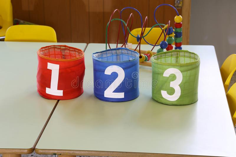 Colorful jar with text one two three in the primary school stock photos