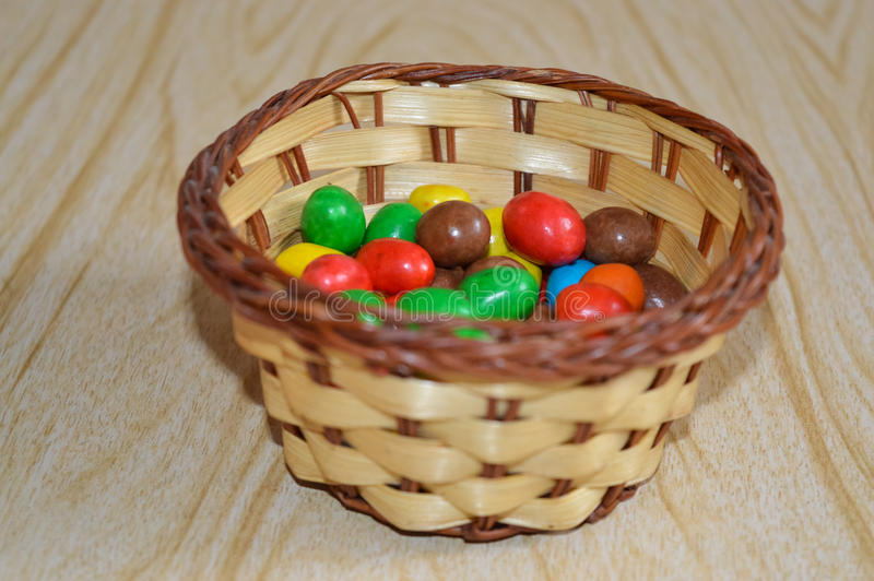 Colorful jelly beans in the basket stock photography