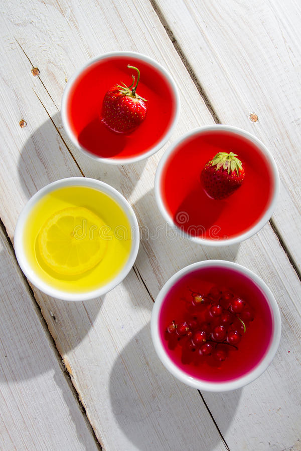 Colorful jelly with berry fruits stock images