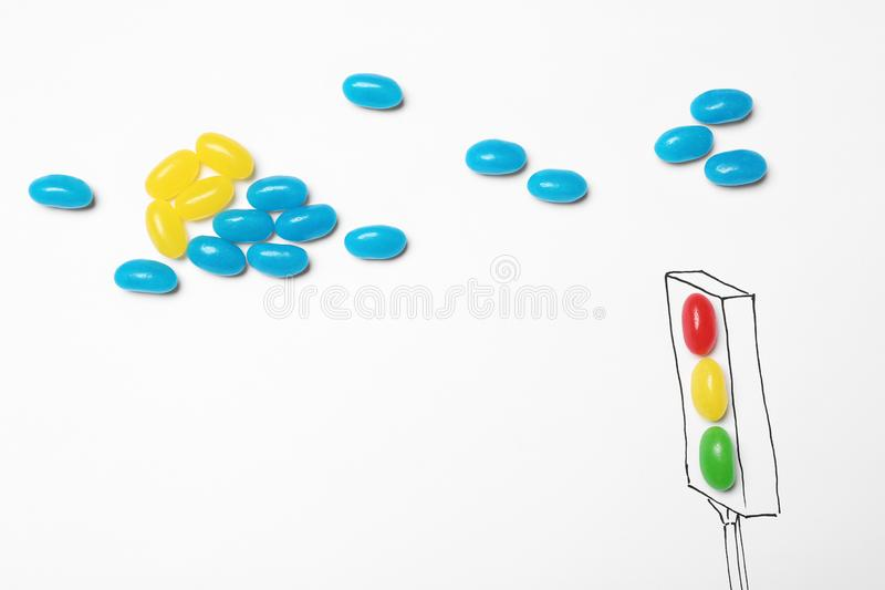 Colorful jelly candies arranged as traffic light, top view royalty free stock photography