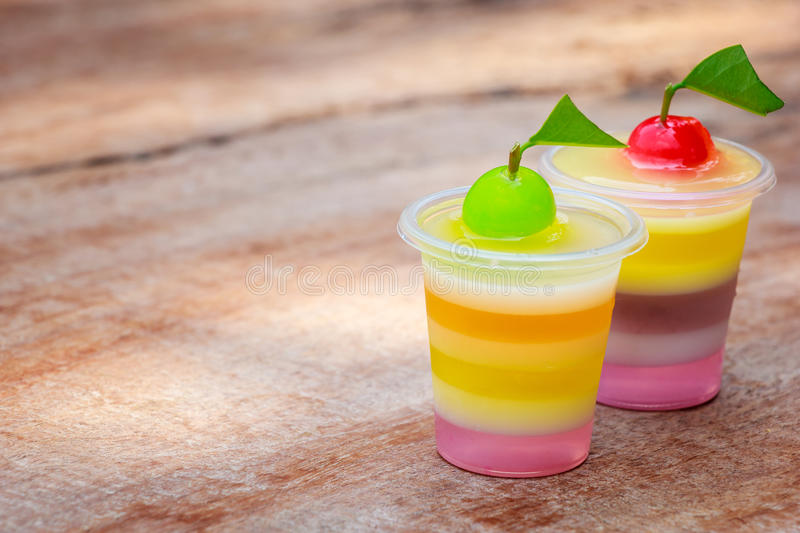 Colorful jellys. With fruits in plastic cups stock images