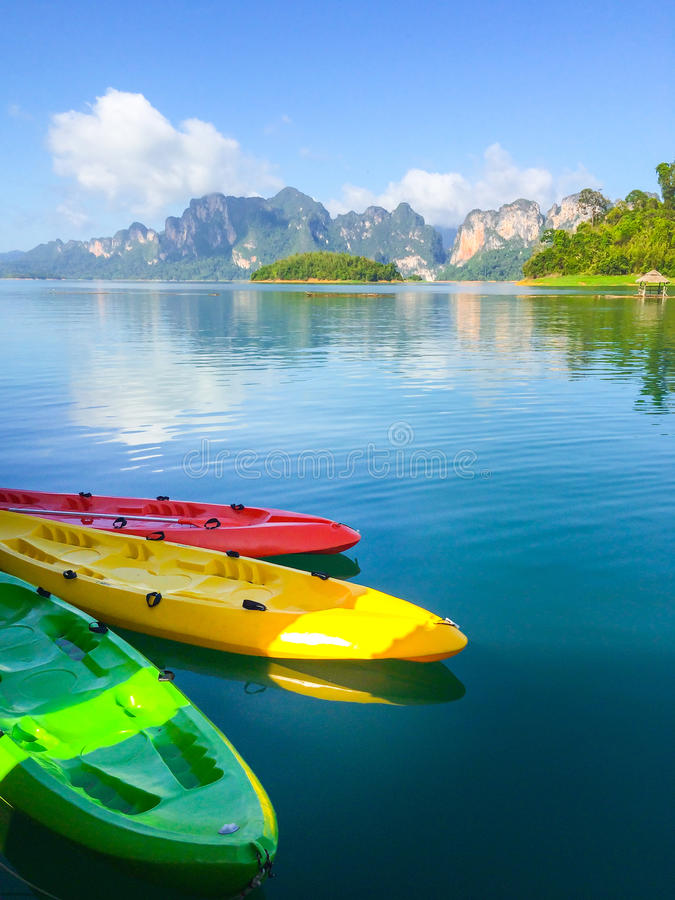 Colorful kayak align the waters of river, Thailand. Kayak. Kayak at the river with space for text wording royalty free stock image