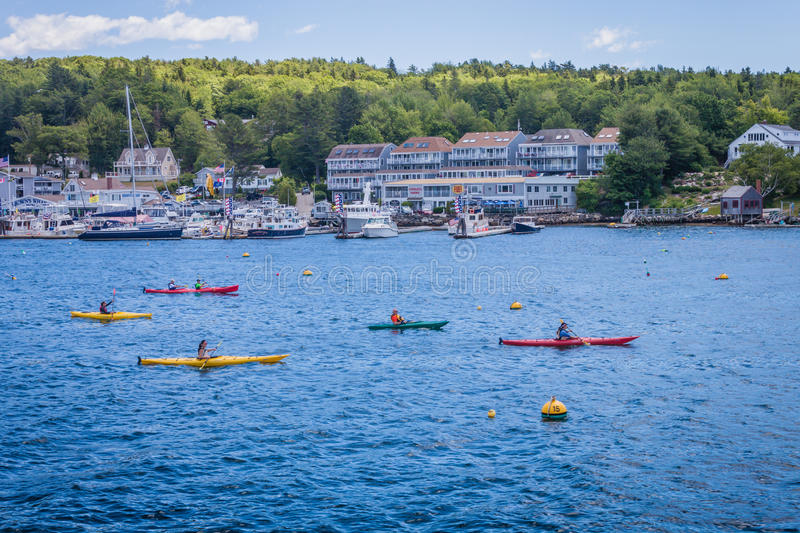 Colorful kayakers paddle in Boothbay Harbor, Maine stock images