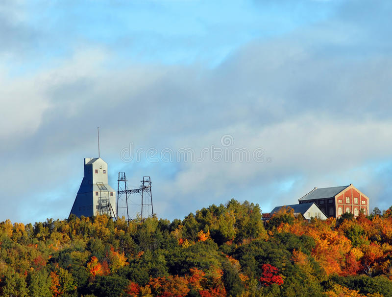 Colorful Keweenaw National Historical Park. Quincy Hill is covered in Autumn color. Quincy Shaft and the Keweenaw National Historical Park sit topping Quincy royalty free stock photo