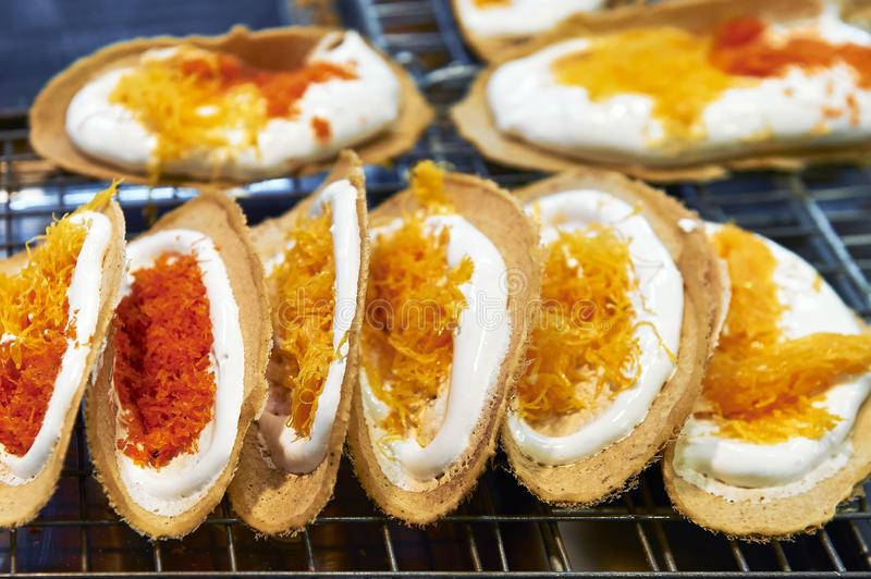 Colorful Khanom Buang crepe pastries sold in Thailand. Sweet colorful Khanom Buang crepe pastries sold at a stall inside MBK Shopping Center in Bangkok, Thailand stock photos