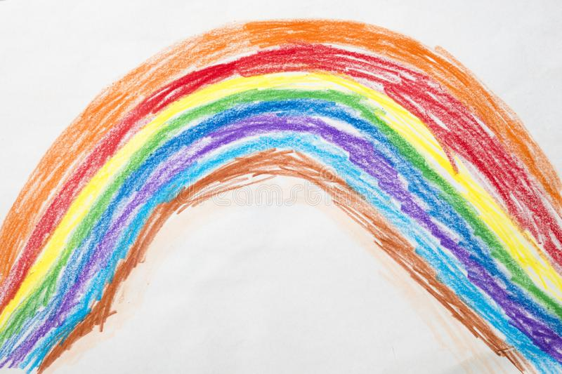 Colorful kid`s drawing of a rainbow stock images