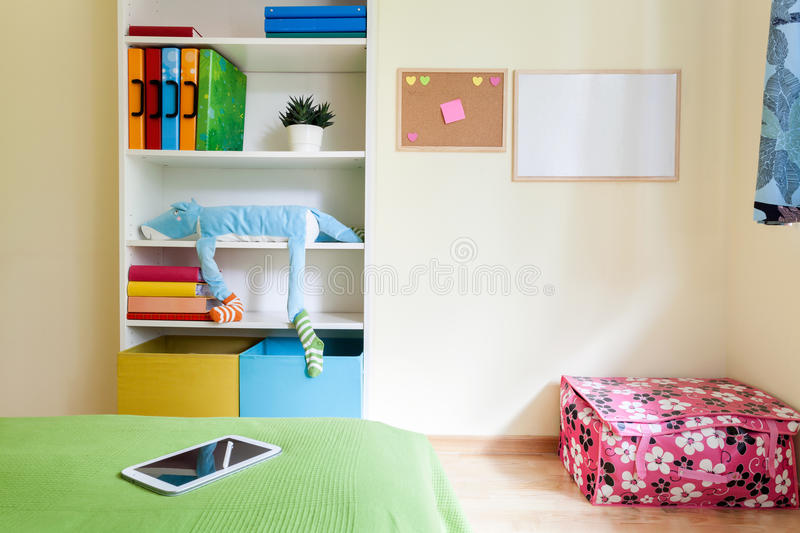Colorful kids room with white bookcase royalty free stock photo